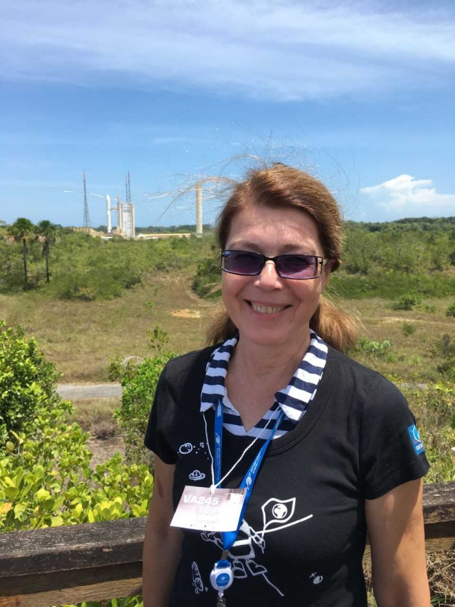 Anu Noorma and rocket Ariane 5 that took the BepiColombo mission into space a few hours after the picture was taken.